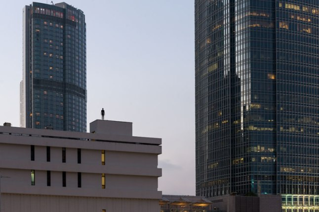 Between International Finance Centre and Four Seasons Hotel (Source: © Antony Gormley's Official Website)